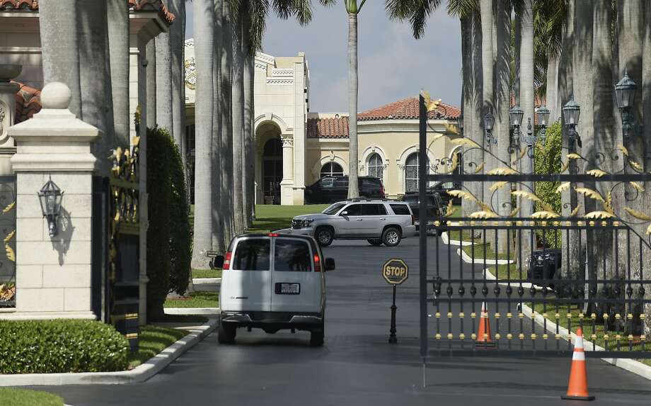A vehicle stops at the gate of the Trump International Golf Club in West Palm Beach, Fla., Sunday, Feb. 19, 2017, while President Donald Trump is at the club. (AP Photo/Susan Walsh) Photo: Susan Walsh, Associated Press