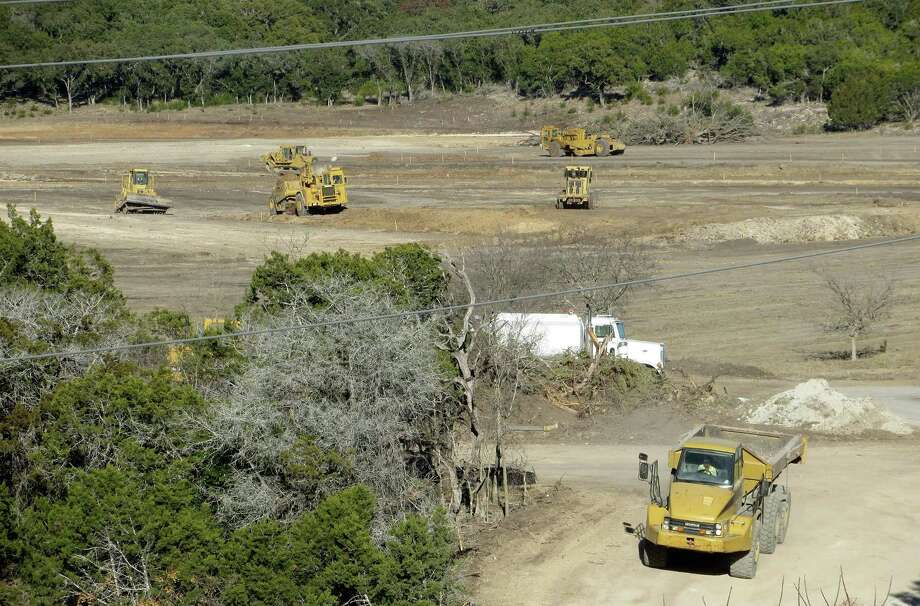 Plans by Kerrville to use treated wastewater to irrigate its new athletic complex, shown here under construction last year, are back on track after Kerr County Commissioners withdrew their objections to the reservoir that will hold the effluent. Photo: /Zeke MacCormack / San Antonio Express-News