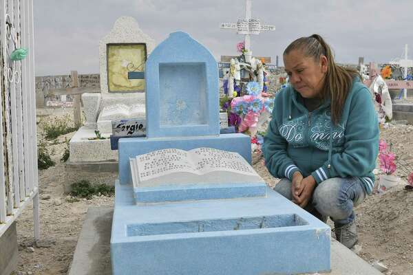 Maria Guadalupe Guereca, 60, visits the grave of her murdered son Sergio Hernandez at the Jardines del Recuerdo cemetery in Ciudad Juarez, Chihuahua, Mexico, during an interview with AFP on February 18, 2017. The shooting occurred June 7, 2010 while Sergio Hernandez was spending time with three friends on the banks of the Rio Grande, which separates Ciudad Juarez in Mexico from El Paso in Texas, US. Sergio was shot dead at 15 by police officer Jesus Mesa. This would have been another tale of tragic and banal violence, had the victim not been in Mexico and the perpetrator in the United States. / AFP PHOTO / Yuri CORTEZYURI CORTEZ/AFP/Getty Images