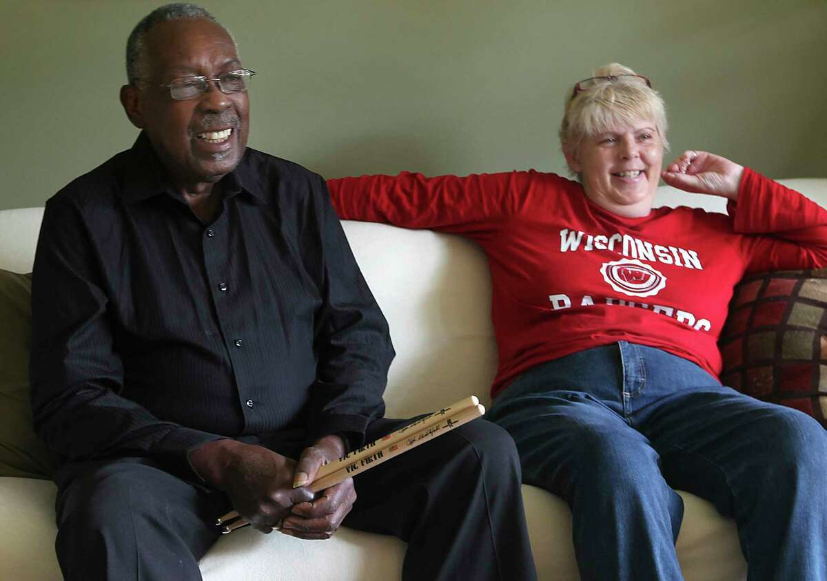 In this Oct. 23, 2013 photo, legendary drummer Clyde Stubblefield, is pictured with his wife Jody Hannon, in their Madison, Wis. home prior to his being honored with the Yamaha Legacy Award Oct. 25, at the Wisconsin State Music Conference in Madison. Stubblefield, a drummer for James Brown who created one of the most widely sampled drum breaks ever, died Saturday, Feb. 18, 2017, at age 73. His wife, Jody, told The Associated Press that Stubblefield died of kidney failure at a Madison, Wis., hospital. (John Hart/Wisconsin State Journal via AP)