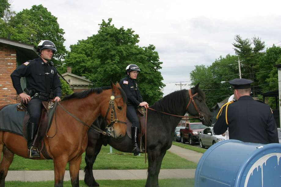Saratoga Springs police Officer Glenn Barrett, left, aboard Jupiter, and Lt. Michael Chowske, right, with King Tut in this 2008 photo. (Courtesy Saratoga Springs Police Department)