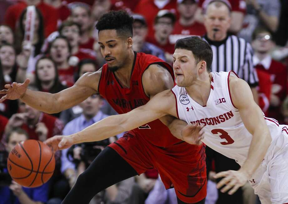 Maryland's Melo Trimble (left) and Wisconsin's Zak Showalter (3) go after the during the second half of an NCAA college basketball game Sunday, Feb. 19, 2017, in Madison, Wis. (AP Photo/Andy Manis) Photo: Andy Manis, Associated Press