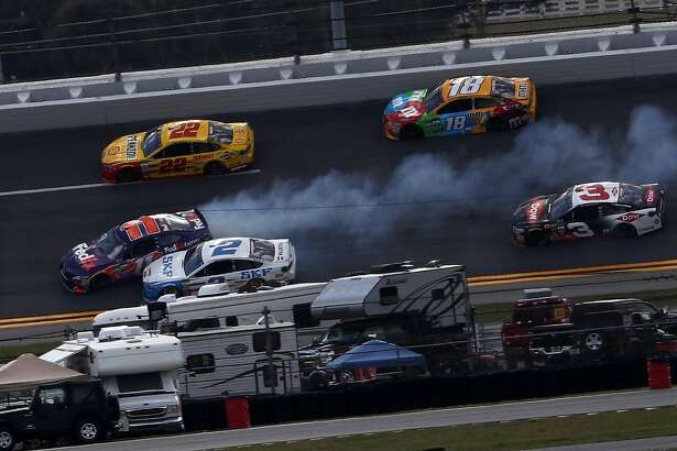 DAYTONA BEACH, FL - FEBRUARY 19:  Denny Hamlin, driver of the #11 FedEx Express Toyota, is involved in an on-track incident during the weather delayed Monster Energy NASCAR Cup Series Advance Auto Parts Clash at Daytona International Speedway on February 19, 2017 in Daytona Beach, Florida.  (Photo by Chris Graythen/Getty Images)