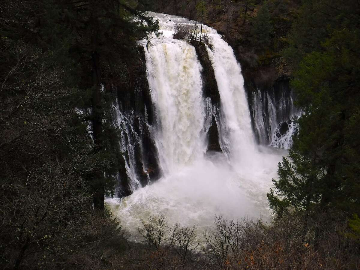 Burney Falls is pumping an estimated 250 gallons of water per day. Burney Falls is a 129-foot waterfall that is the centerpiece of McArthur-Burney Falls Memorial State Park in Northern California. It is fed by Burney Creek as well as flows from underground lava tubs that emerge as subliminal curtain flows at mid-wall.