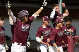 Magnolia's Adam Nguyen, left, celebrates a grand-slam by Justin Collins during the first inning of a high school baseball scrimmage against Kingwood Saturday, Feb. 11, 2017, in Magnolia. Colins' home run was the first of his high school career.