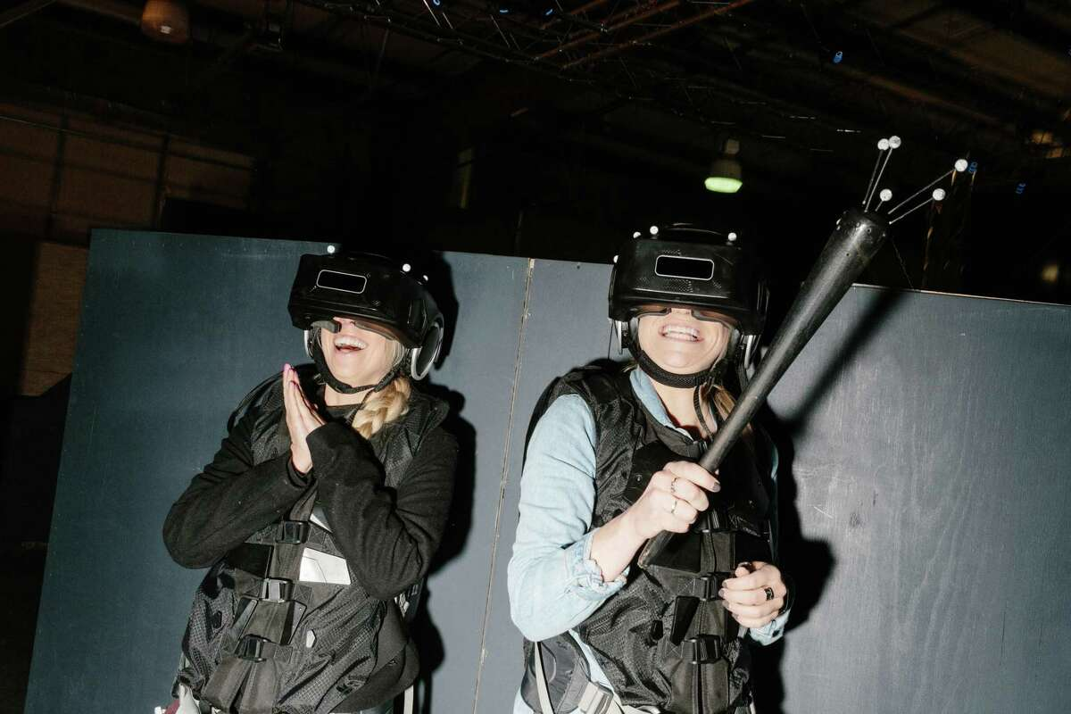 The Void, a virtual reality experience based in Lindon, Utah, offers thrill seekers like Sarah Topham, left, and Ashley Hess a new type of experience by refining the concept of mapping a virtual world over a physical set.