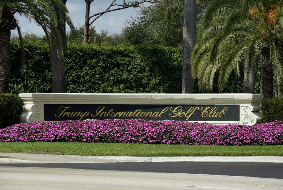 Flowers frame the front of the sign for the Trump International Golf Club in West Palm Beach, Fla., Sunday, Feb. 19, 2017, while President Donald Trump is at the club. (AP Photo/Susan Walsh) Photo: Susan Walsh, STF / Copyright 2017 The Associated Press. All rights reserved.