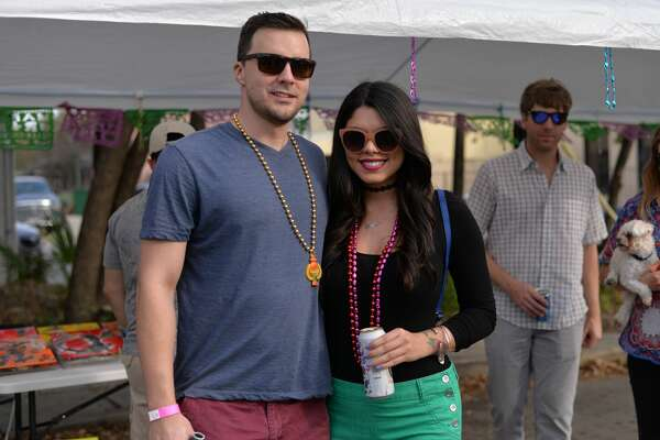 The owners of the The Cookhouse food tuck hosted an early Mardi Gras bash in San Antonio Sunday afternoon, Feb. 19, 2017, along St. Mary's Street. Here's a look at all the food, dancing and revelers.