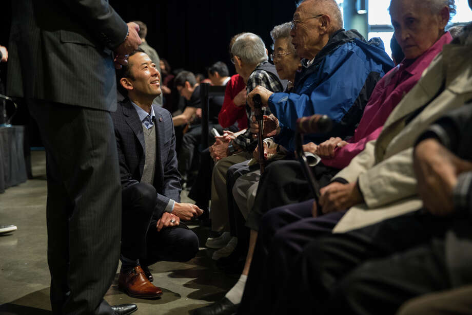 Michael Shiosaki and husband Mayor Ed Murray greet Japanese internment survivors during Never Again: Japanese American WWII History and American Muslim Rights Today at Fisher Pavilion on Sunday, Feb. 19, 2017. Photo: GRANT HINDSLEY, SEATTLEPI.COM / SEATTLEPI.COM