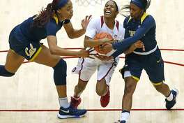 Stanford's Briana Roberson is fouled while driving between California's Kristine Anigwe and Asha Thomas in 2nd quarter during PAC 12 women's basketball game at Maples Pavilion in Stanford, Calif., on Sunday, February 19, 2017.