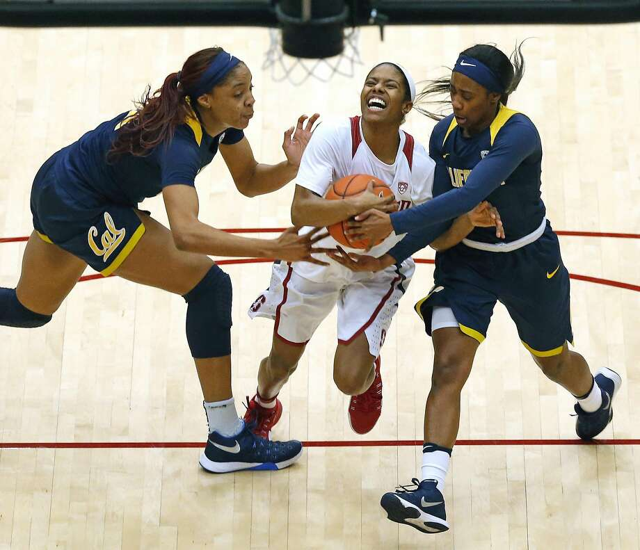 Stanford's Briana Roberson is fouled while driving between Cal's Kristine Anigwe (left) and Asha Thomas in the second quarter. Photo: Scott Strazzante, The Chronicle