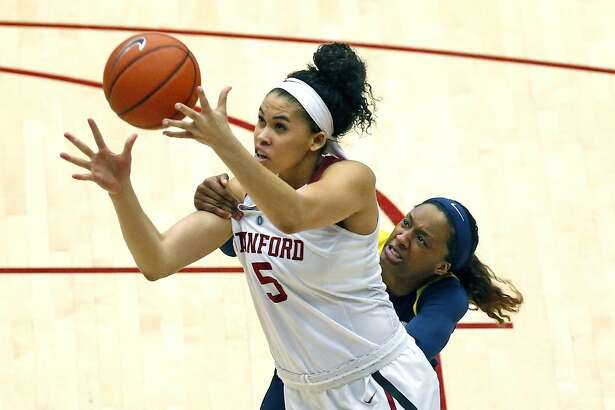 Stanford's Kaylee Johnson is fouled by California's Courtney Range in 1st quarter during PAC 12 women's basketball game at Maples Pavilion in Stanford, Calif., on Sunday, February 19, 2017.