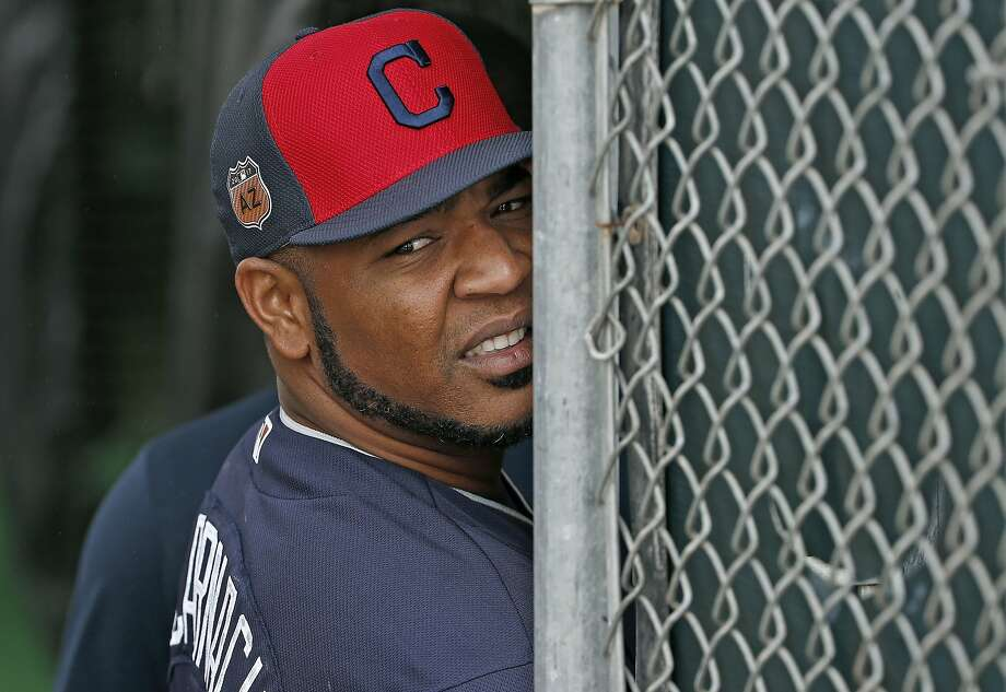 Cleveland Indians first baseman and designated hitter Edwin Encarnacion watches the rain fall from the batting cages at the Indians baseball spring training facility, Sunday, Feb. 19, 2017, in Goodyear, Ariz. (AP Photo/Ross D. Franklin) Photo: Ross D. Franklin, Associated Press