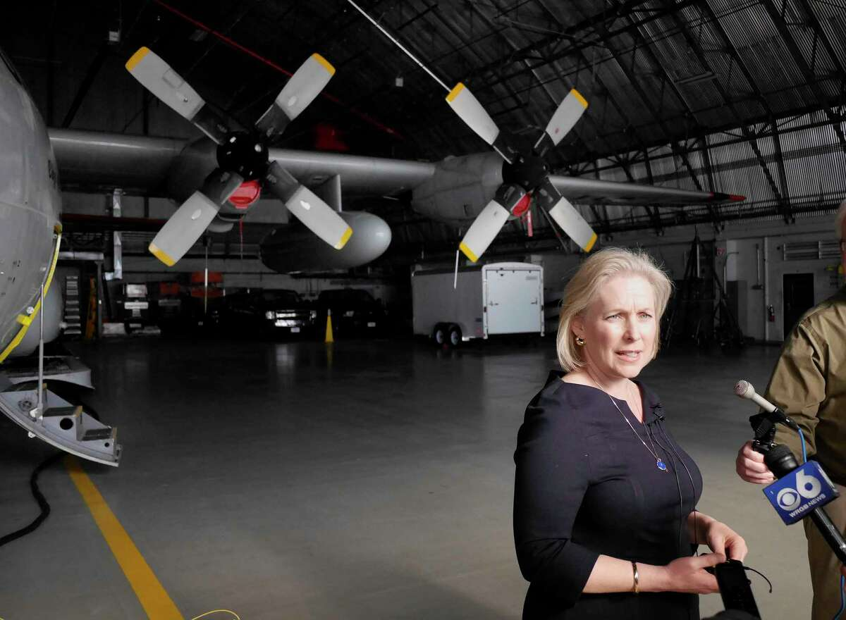 Standing near an LC-130 airplane, Senator Kirsten Gillibrand talks to members of the media during a tour of the 109th Airlift Wing at Stratton Air Base on Sunday, Feb. 19, 2017, in Schenectady, N.Y. (Paul Buckowski / Times Union)