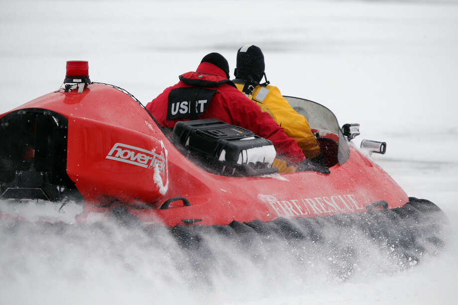 In this Feb. 13, 2017 photo, rescue crews use a hovercraft to search the frigid waters of Conesus Lake in Livonia, N.Y., for two missing snowmobilers who are believed to have fallen through the ice. Not-so-frozen lakes have claimed several snowmobilers across the Northeast so far in a relatively mild winter. (Max Schulte/Democrat & Chronicle via AP) ORG XMIT: NYROD501 Photo: Max Schulte / Democrat & Chronicle