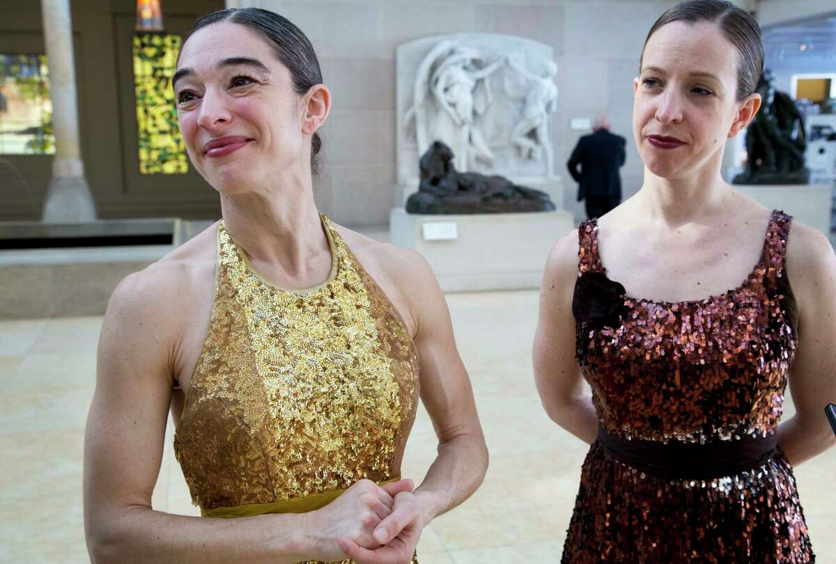In this Feb. 10, 2017 photo, dancers Monica Bill Barnes, left, and Anna Bass, discuss the museum workout they were commissioned to lead at the Metropolitan Museum of Art in New York.