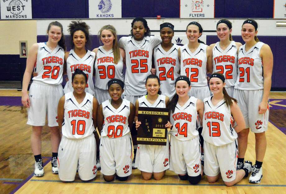 The Edwardsville girls' basketball team poses with the Class 4A Collinsville Regional championship plaque after defeating Belleville East on Thursday.