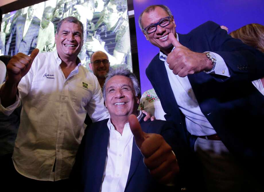 Ecuador's President Rafael Correa, from left, Lenin Moreno, presidential candidate for the ruling party Alliance PAIS, and running mate Vice President Jorge Glas, flash thumbs up as they celebrate the closing of the polls for the general election, in Quito, Ecuador, Sunday, Feb. 19, 2017. Ecuadoreans voted for a new leader Sunday, and exit polls indicated, Moreno, Correa's hand-picked successor was close to the threshold needed to win outright and avoid a runoff against his nearest rival. (AP Photo/Dolores Ochoa) Photo: Dolores Ochoa, STF / Copyright 2017 The Associated Press. All rights reserved.