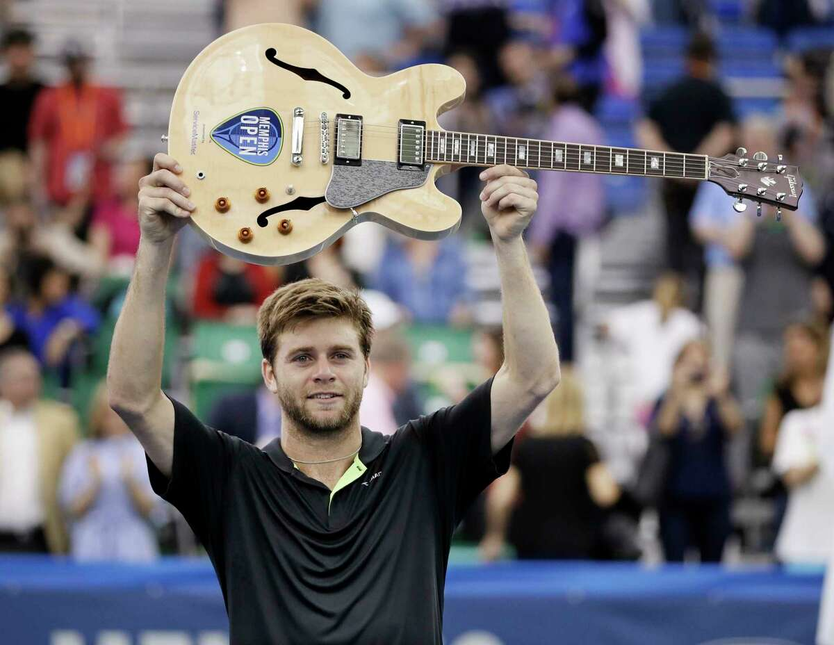 Ryan Harrison, of the United States, celebrates with his guitar trophy after defeating Nikoloz Basilashvili in the singles championship at the Memphis Open tennis tournament Sunday, Feb. 19, 2017, in Memphis, Tenn. (AP Photo/Mark Humphrey) ORG XMIT: TNMH121