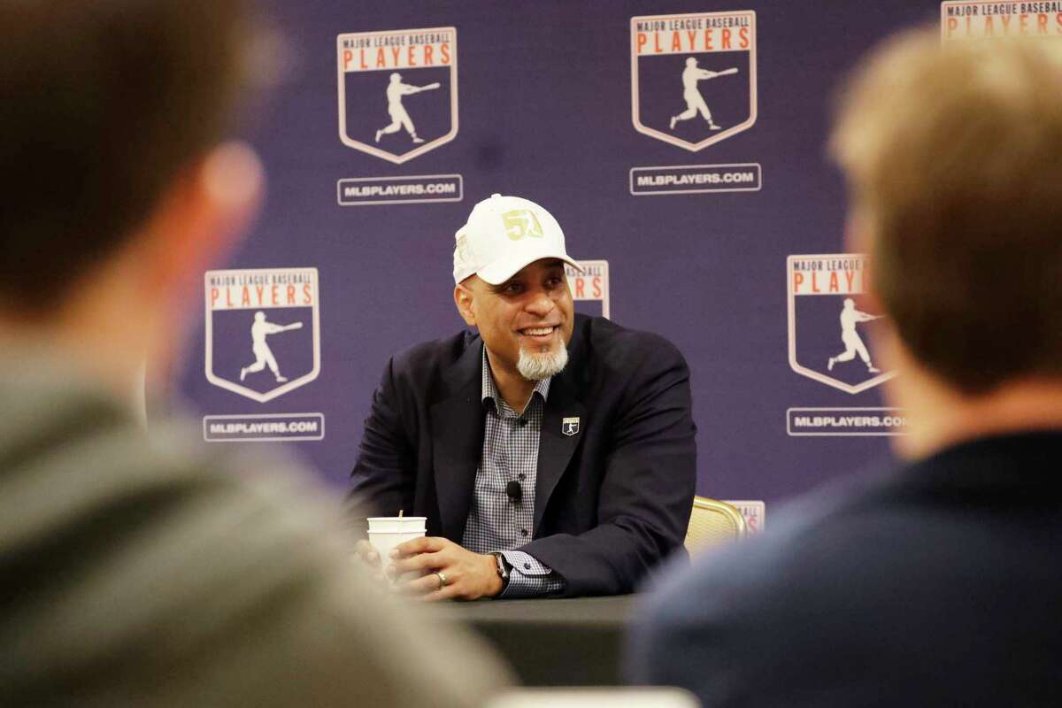 Executive Director of the Major League Players Association Tony Clark answers questions at a news conference Sunday, Feb. 19, 2017, in Phoenix. (AP Photo/Morry Gash) ORG XMIT: AZMG105