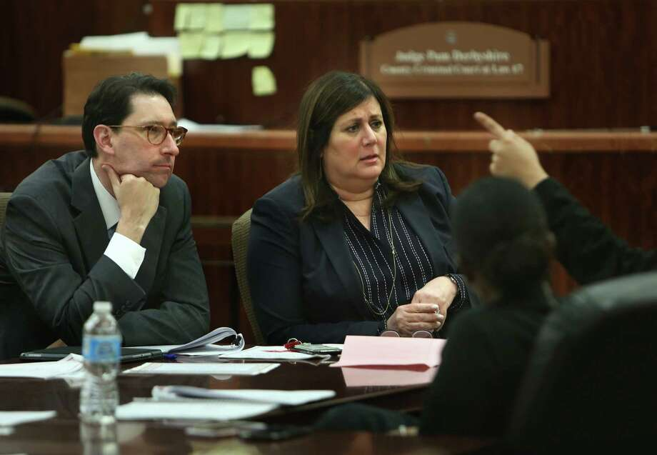 From left, Justice William J. Boyce and Judge Pam Derbyshire listen to a participant Wednesday in a SAFE court session. Photo: Mark Mulligan, Staff / © 2017 Houston Chronicle