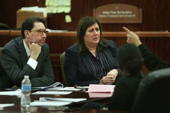 From left, Justice William J. Boyce and Judge Pam Derbyshire listen to a participant Wednesday in a SAFE court session.