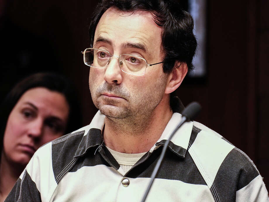 Dr. Larry Nassar listens to testimony of a witness during a preliminary hearing Friday, Feb. 17, 2017, in Lansing, Mich. A judge on Friday ordered Nassar, a former Michigan State University and USA Gymnastics sports doctor, to stand trial on sexual assault charges. He is accused of assaulting a girl from the age of 6 until the girl was 12 at his home in Holt, Mich. He has pleaded not guilty. (Robert Killips/Lansing State Journal via AP) Photo: Robert Killips, MBR / Lansing State Journal