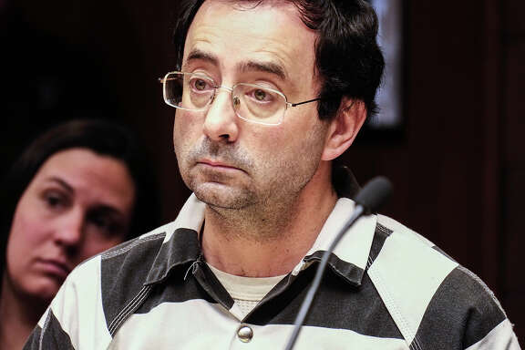 Dr. Larry Nassar listens to testimony of a witness during a preliminary hearing Friday, Feb. 17, 2017, in Lansing, Mich. A judge on Friday ordered Nassar, a former Michigan State University and USA Gymnastics sports doctor, to stand trial on sexual assault charges. He is accused of assaulting a girl from the age of 6 until the girl was 12 at his home in Holt, Mich. He has pleaded not guilty. (Robert Killips/Lansing State Journal via AP)