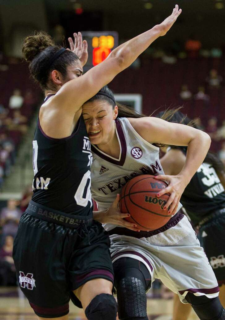 Texas A&M's Danni Williams, right, finds Mississippi State's Dominique Dillingham to be an obstacle Sunday.