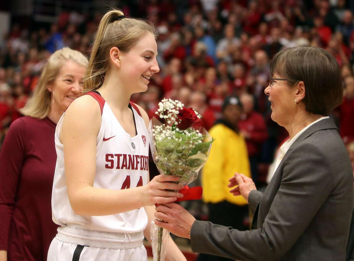 Stanford senior Karlie Samuelson receives flowers from head coach Tara VanDerveer as Samuelson is honored after Cardinal's 72-54 win over California in PAC 12 women's basketball game at Maples Pavilion in Stanford, Calif., on Sunday, February 19, 2017.