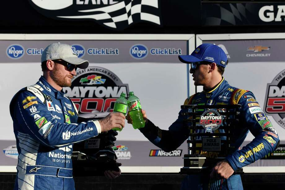 Hendrick Motorsports teammates Chase Elliott, left, and Dale Earnhardt Jr. toast each other after qualifying 1-2 for Sunday's Daytona 500 - NASCAR's season-opening Monster Energy Series race. Photo: Jared C. Tilton, Stringer / 2017 Getty Images