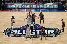 NEW ORLEANS, LA - FEBRUARY 19:  LeBron James #23 of the Cleveland Cavaliers and Anthony Davis #23 of the New Orleans Pelicans battle for the opening tip-off at the start of the 2017 NBA All-Star Game at Smoothie King Center on February 19, 2017 in New Orleans, Louisiana. NOTE TO USER: User expressly acknowledges and agrees that, by downloading and/or using this photograph, user is consenting to the terms and conditions of the Getty Images License Agreement.  (Photo by Jonathan Bachman/Getty Images)