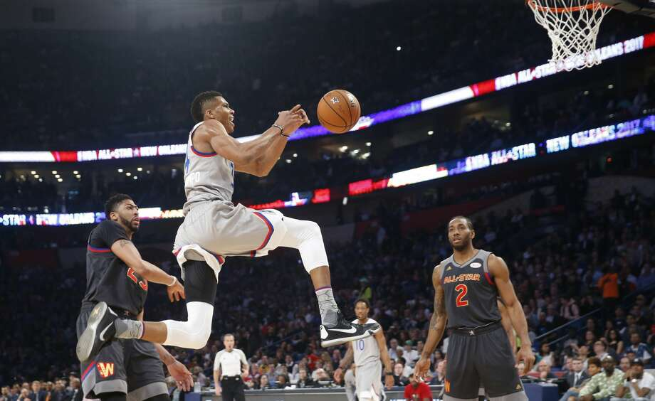 Eastern Conferences forward Giannis Antetokounmpo of the Milwaukee Bucks (34) goes for a layup against Western Conference forward Anthony Davis of the New Orleans Pelicans (23) and Western Conference forward Kawhi Leonard of the San Antonio Spurs (2) during the first half of the NBA All-Star basketball game in New Orleans, Sunday, Feb. 19, 2017. (AP Photo/Gerald Herbert) Photo: Gerald Herbert/Associated Press