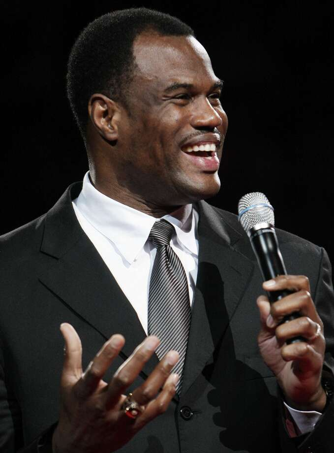 FILE - This Nov. 29, 2009 file photo shows former San Antonio Spurs player David Robinson addresing fans during a ceremony celebrating his induction into the Naismith Memorial Basketball Hall of Fame in San Antonio. Robinson will be among the speakers at a motivational business event in San Antonio. Photo: Darren Abate/Associated Press
