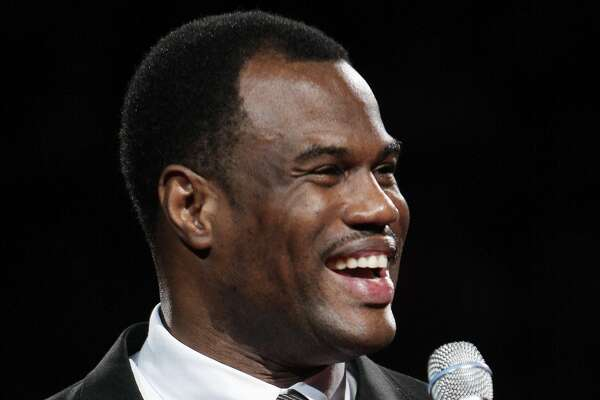 FILE - This Nov. 29, 2009 file photo shows former San Antonio Spurs player David Robinson addresing fans during a ceremony celebrating his induction into the Naismith Memorial Basketball Hall of Fame in San Antonio. Robinson was among the honorees Sunday, Feb. 19, 2017 at the National Basketball Retired Players Association's annual Legends Brunch, several hours before tip-off of the All-Star game. Robinson was chosen as the group's Humanitarian of the Year, and Hill is the Community Ambassador of the Year. (AP Photo/Darren Abate)
