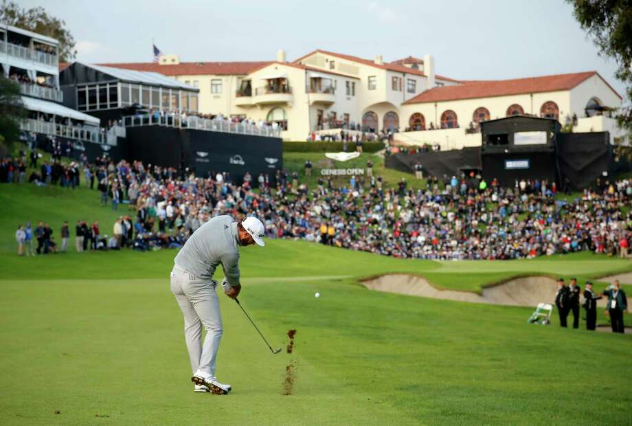 Dustin Johnson hits his approach shot on the 18th fairway during the final round of the Genesis Open golf tournament at Riviera Country Club on Sunday, Feb. 19, 2017, in the Pacific Palisades area of Los Angeles. (AP Photo/Ryan Kang) ORG XMIT: CARK128 Photo: Ryan Kang / FR171219 AP