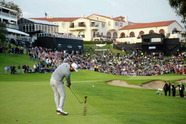 Dustin Johnson hits his approach shot on the 18th fairway during the final round of the Genesis Open golf tournament at Riviera Country Club on Sunday, Feb. 19, 2017, in the Pacific Palisades area of Los Angeles. (AP Photo/Ryan Kang) ORG XMIT: CARK128