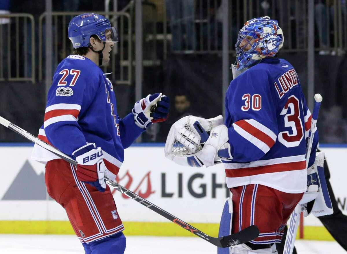 New York Rangers goalie Henrik Lundqvist, right, and Ryan McDonagh celebrate after an NHL hockey game against the Washington Capitals, Sunday, Feb. 19, 2017, in New York. (AP Photo/Seth Wenig) ORG XMIT: NYSW112