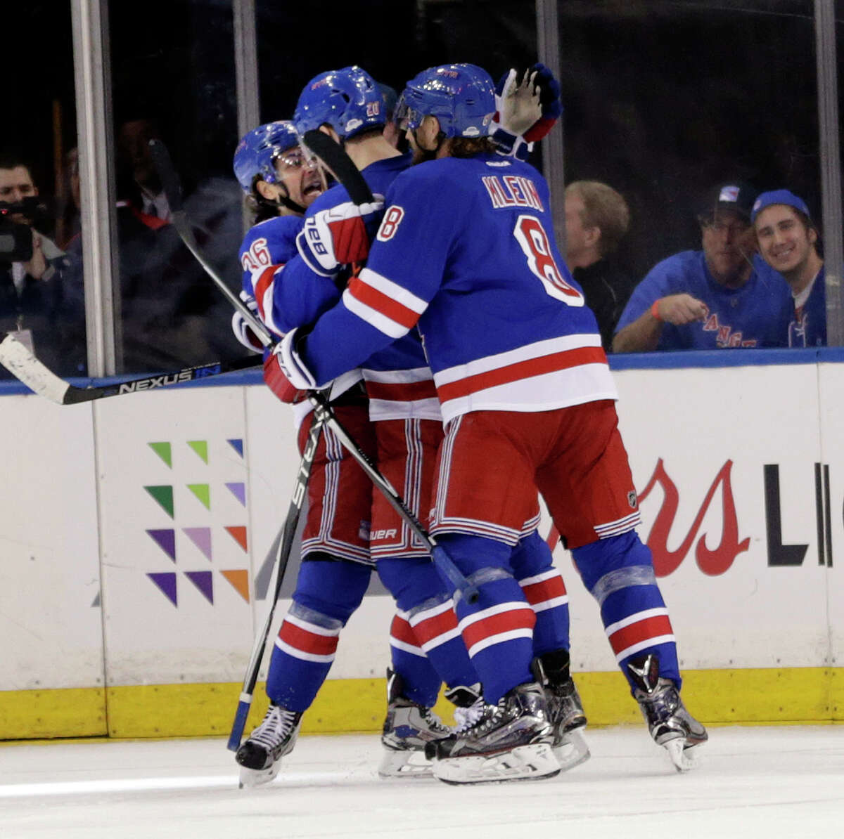 New York Rangers' Mats Zuccarello, left, celebrates with teammates after scoring the winning goal during the third period of the NHL hockey game against the Washington Capitals, Sunday, Feb. 19, 2017, in New York. (AP Photo/Seth Wenig) ORG XMIT: NYSW108