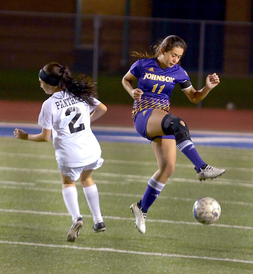 LBJ's Karen Cantu controls the ball as United South's Amanda Salinas defends. The Lady Wolves and Lady Panthers played to a 1-1 tie on Friday. Photo: Cuate Santos /Laredo Morning Times / Laredo Morning Times