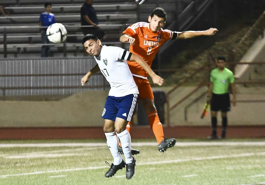 United's Martell Gonzalez and Alexander's Jesus Gonzalez battle for possession during their game on Friday night, a contest the Longhorns won 2-1. Photo: Danny Zaragoza /Laredo Morning Times / LAREDO MORNING TIMES