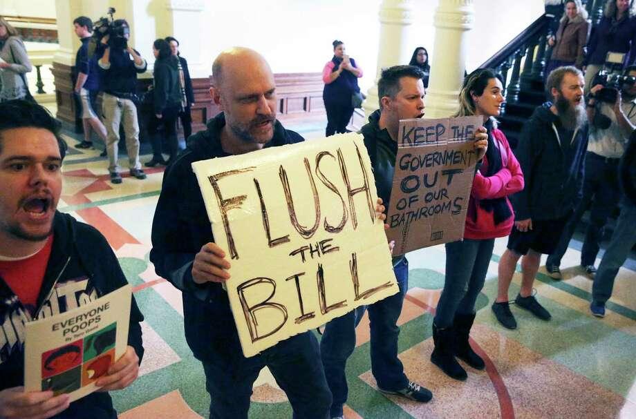 Protestors bhant in the hall as Lt. Governor Dan Patrtick announces legislation by Senator Lois Kolkhorst (R-Brenham) concerning bathroom access rules in Texas on January 5, 2017. Photo: Tom Reel, Staff / 2017 SAN ANTONIO EXPRESS-NEWS