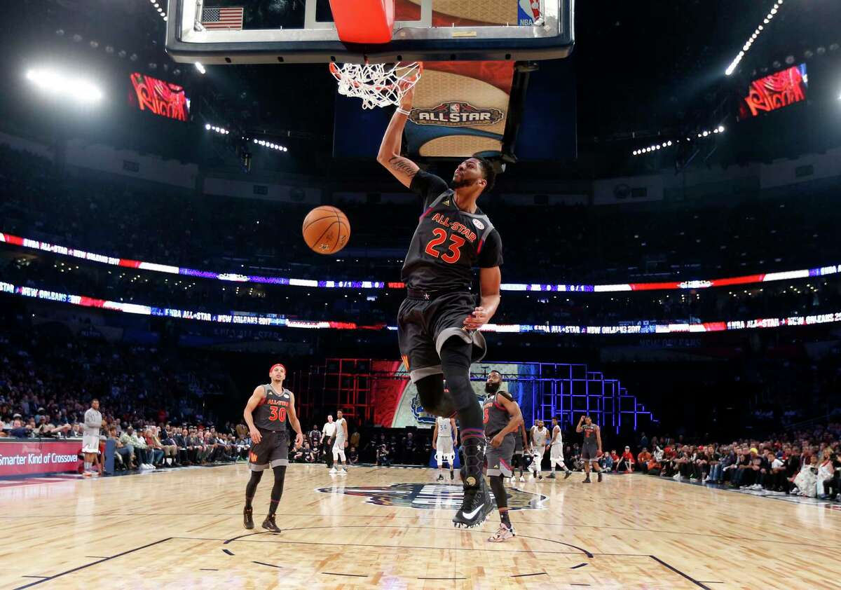 Western Conference forward Anthony Davis of the New Orleans Pelicans (23 ) slam dunks during the first half of the NBA All-Star basketball game in New Orleans, Sunday, Feb. 19, 2017. (AP Photo/Gerald Herbert, Pool) ORG XMIT: LAGH302