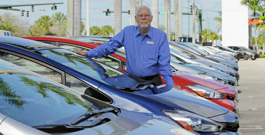 "In this Friday, Feb. 10, 2017, photo, Earl Stewart, owner of a Toyota dealership, poses for a photo at his business in North Palm Beach, Fla. Stewart advises people to ignore dealer advertising. ""Probably 99 percent of it is misleading,"" he said. But armed with the right information, a buyer can navigate the new car sales maze and get 20 percent or more off a car's sticker price. (AP Photo/Alan Diaz) Photo: Alan Diaz, STF / Copyright 2017 The Associated Press. All rights reserved."