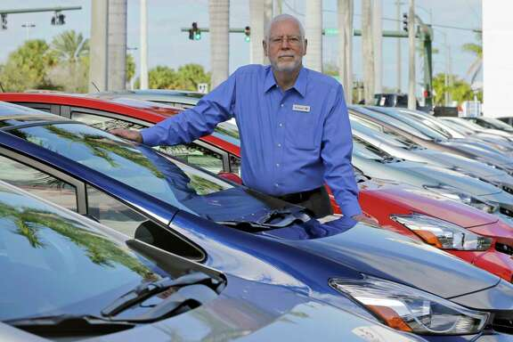 "In this Friday, Feb. 10, 2017, photo, Earl Stewart, owner of a Toyota dealership, poses for a photo at his business in North Palm Beach, Fla. Stewart advises people to ignore dealer advertising. ""Probably 99 percent of it is misleading,"" he said. But armed with the right information, a buyer can navigate the new car sales maze and get 20 percent or more off a car's sticker price. (AP Photo/Alan Diaz)"