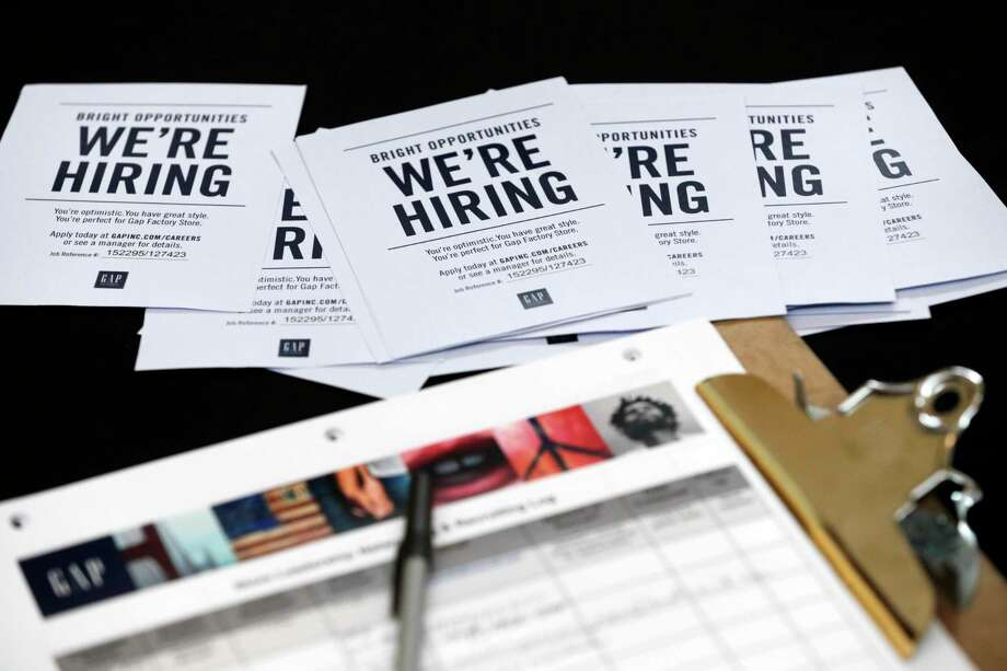 FILE - In this Tuesday, Oct. 6, 2015, file photo, job applications and information for the Gap Factory Store sit on a table during a job fair at Dolphin Mall in Miami.  Fewer Americans applied for unemployment benefits last week of Aug. 2016, another sign the U.S. job market remains healthy despite a downshift in hiring in August. The Labor Department says the number of applications for jobless aid slid by 4,000 last week to a seasonally adjusted 259,000, lowest since mid-July. (AP Photo/Wilfredo Lee, File) Photo: Wilfredo Lee, STF / Copyright 2016 The Associated Press. All rights reserved. This material may not be published, broadcast, rewritten or redistribu