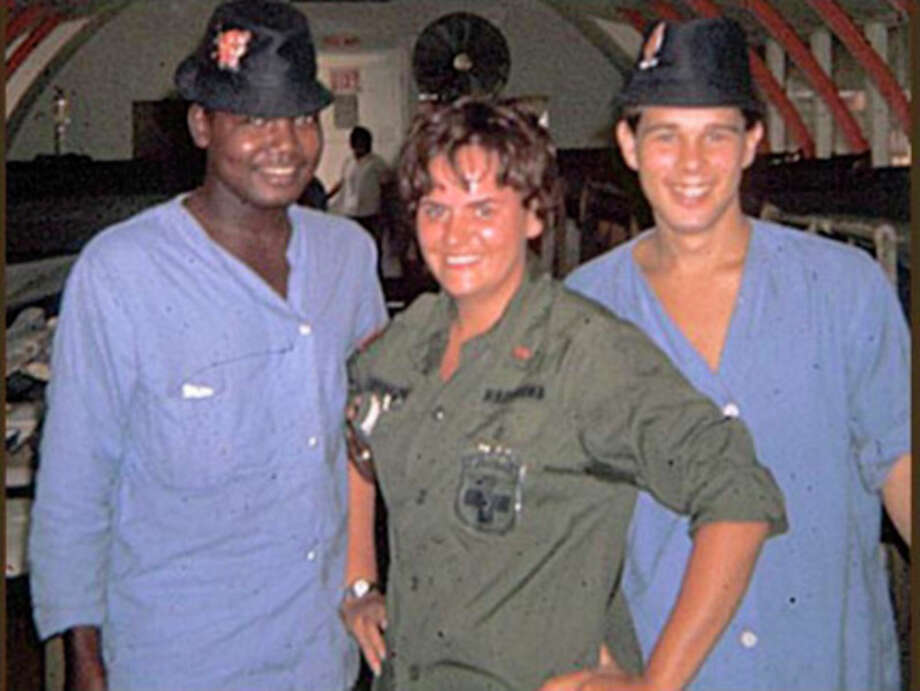 Margaret Flatt, middle, served in Vietnam.