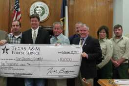 The San Jacinto County Commissioners Court meeting on Feb. 14 began with the acceptance of $10,000 from the Texas Forest Service for the Community Wildlife Protection Plan.