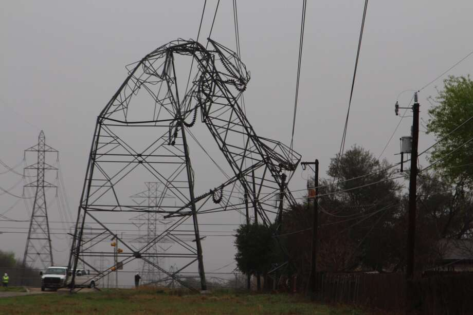 Stay away from downed power lines: Report them to CPS Energy. Do NOT attempt to move or drive over the lines. Even in an outage, power lines may still have electricity running through them. Photo: Vincent Davis / San Antonio Express-News
