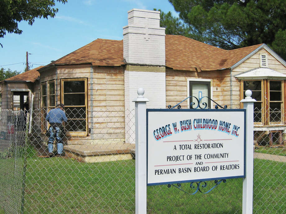 File photo from 2004 shows work being done on the George W. Bush Childhood Home project in Midland, Texas. The house was home to two U.S. presidents, George H.W. Bush and his son, in the early 1950s. The house was listed on the National Register of Historic Places that year. (AP Photo/Betsy Blaney). Photo: BETSY BLANEY/AP